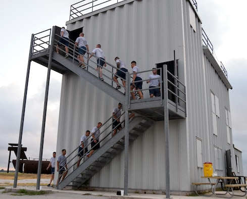The 433rd Civil Engineer Squadron firefighters climb stairs of the fire training building to honor the first responders lost during the Sept. 11, 2001 attacks on the World Trade Center during a 9/11 Memorial Stair Climb Sept. 8, 2019 at Joint Base San Antonio-Lackland. The firefighters climbed stairs 55 times to equal the 110 floors of World Trade Center twin tower buildings.