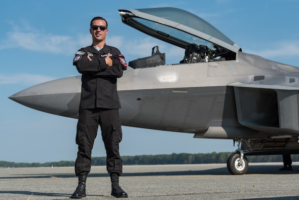 Staff Sgt. Zach Zistl, F-22 Raptor dedicated crew chief, poses for a photo Sept. 12, 2019, at Dover Air Force Base, Del. Zistl, a member of the F-22 demonstration team from Joint Base Langley-Eustis, Va., arrived here for the Thunder Over Dover 2019 open house and air show. (U.S. Air Force photo by Roland Balik)
