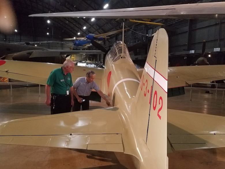Left to right, Roger Deere and Dr. Asai discuss the remodeled Japanese Zero aircraft used in WWII.(U.S. Air Force photo/Laura McGowan)