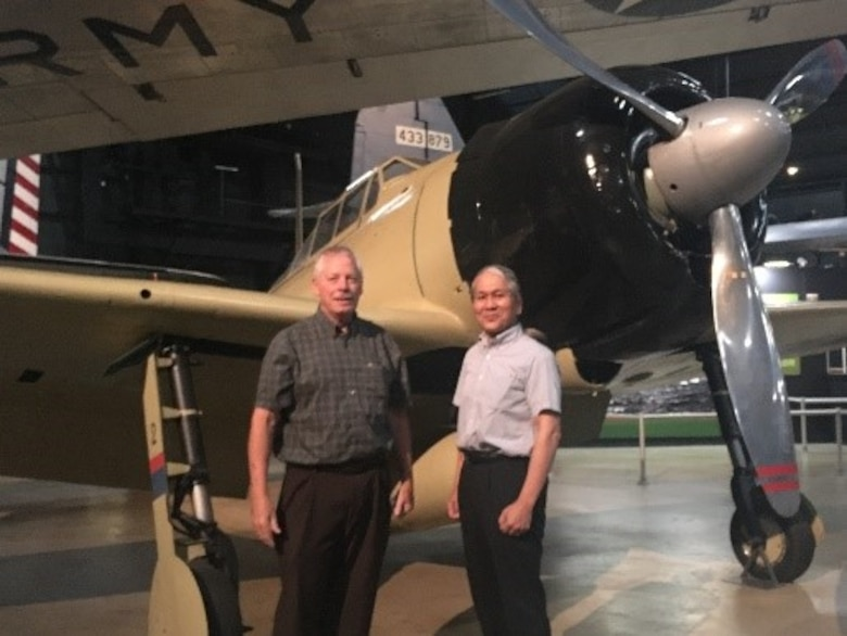 Left to right, Gary Dale, technology lead, Rapid Global Mobility, Aerospace Systems Directorate, Air Force Research Laboratory, and Dr. Asai, and pose in front of the remodeled Zero.(Courtesy photo)