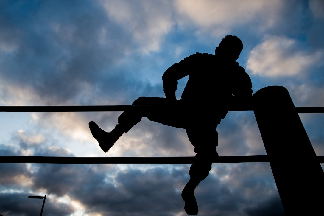 U.S. Marine Lance Cpl. Andrew Cortez, a student with Lance Corporal Seminar Class 4-19, climbs over the double bar obstacle at the 14 Area obstacle course on Marine Corps Base Camp Pendleton, California, Sept. 11, 2019. The class, hosted by Headquarters and Support Battalion, Marine Corps Installations West, Marine Corps Base Camp Pendleton, conducted a memorial physical training session in honor of the 2,977 lives lost during the 9/11 terrorist attacks. Class 4-19 is scheduled to graduate Sept. 13, 2019.