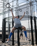 Capt. Noah Palicia attacks the rings on the Alpha Warrior Proving Ground , Selma, Texas, Sept. 9, 2019 during the Air Force Alpha Warrior Final Battle. The annual competition crowns the Air Force's top Alpha Warriors with the top three men and three women forming the Air Force Alpha Warrior Team. The Air Force partnered with Alpha Warrior three years ago to deliver functional fitness training to Airmen and their families.