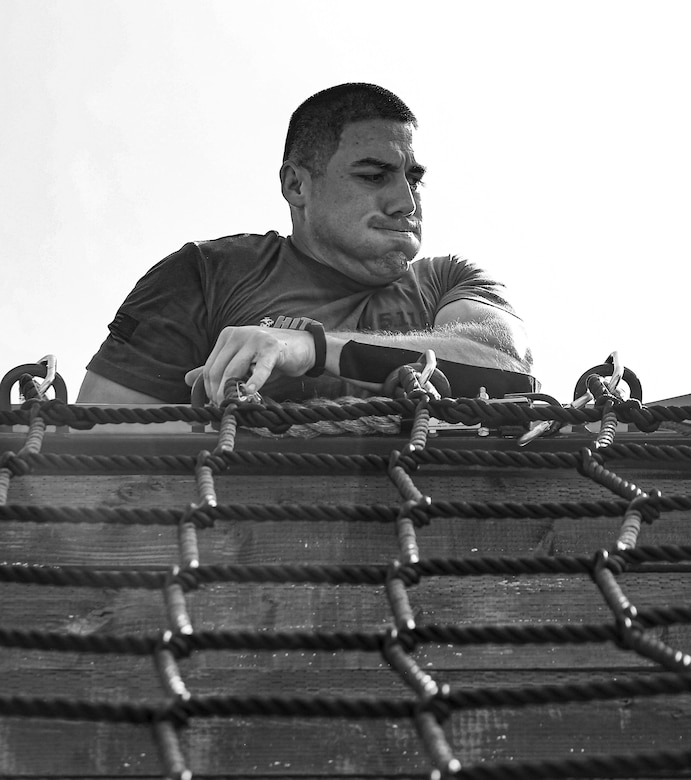 Sgt. Miguel Cornejo, Marine Corps Recruit Depot Parris Island, South Carolina, climbs over the rope wall during the 4th challenge of the 5th annual 2019 High Intensity Tactical Training Championship at Butler Stadium, Marine Corps Base Quantico Va., Sept. 10, 2019. The 4th challenge consisted of more than 600 yards of various sprints, crawls, tire flips, sled drags, and farmers carries.