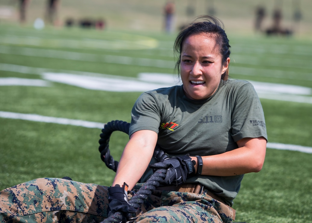 Capt. Stefanie Allen, Marine Corps Base Quantico, Va., competes in the fourth challenge of the High Intensity Tactical Training Championship at Butler Stadium aboard Marine Corps Base Quantico, Va., Sep. 10, 2019. The fourth challenge consisted of going over the BeaverFit Assault Rig, and race through an obstacle course that has various sprints, crawls, tire flips, sled drags, farmer's carries, and others totaling over six-hundred yards.