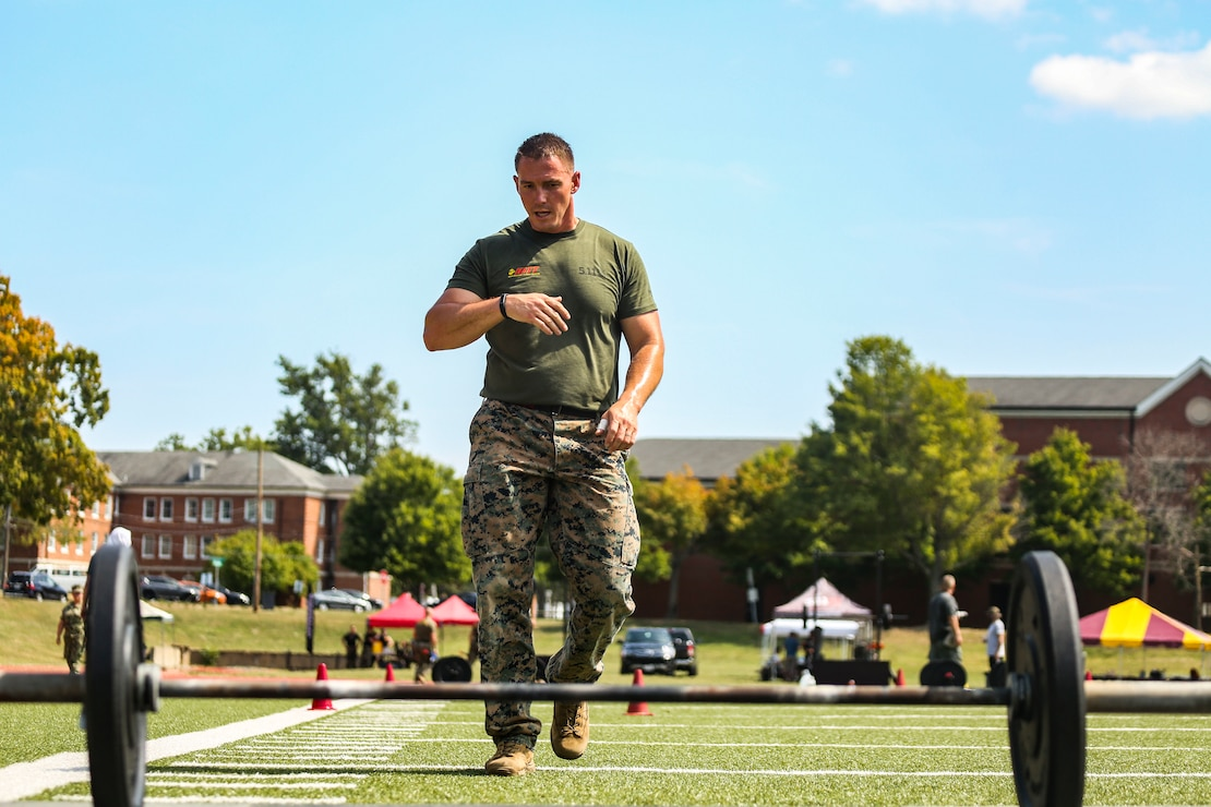 Gunnery Sgt. Justin Gates, Marine Corps Base Quantico, Va., approaches a bar-bell during the 4th challenge of the 5th annual 2019 HITT CHAMPIONSHIP at Butler Stadium, Marine Corps Base Quantico Va., Sept. 10, 2019. The 4th challenge consisted of more than 600 yards of various sprints, crawls, tire flips, sled drags, and farmers carries.The HITT Championship tests Marines athleticism and combat readiness by competing in various physical events testing strength, speed, agility and power.