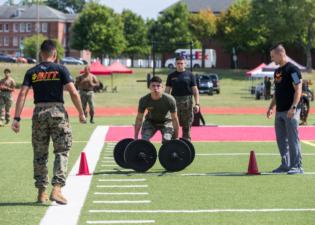 A U.S. Marine competes in the fourth challenge of the High Intensity Tactical Training Championship at Butler Stadium aboard Marine Corps Base Quantico, Va., Sep. 10, 2019. The fourth challenge consisted of going over the BeaverFit Assault Rig, and race through an obstacle course that has various sprints, crawls, tire flips, sled drags, farmer's carries, and others totaling over six-hundred yards.
