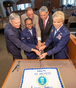 (From left) As is the Air Force birthday tradition, District 10 Councilman Clayton Perry, who served as the oldest Airman, Airman 1st Class Charzell Lewis served as the youngest Airman with the assistance of District 9 Councilman John Courage,  San Antonio Mayor Ron Nirenberg and Brig. Gen. Laura Lenderman, 502nd Air Base Wing and Joint Base San Antonio commander.