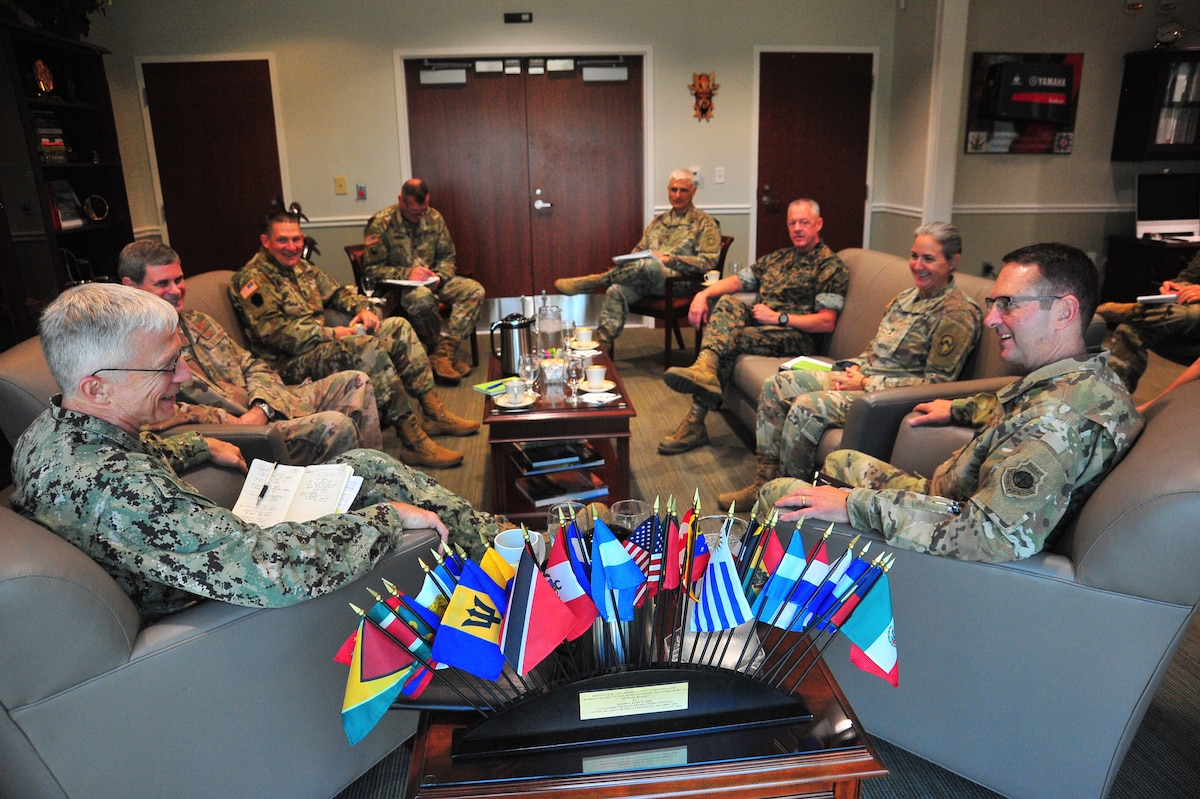 A group of military leaders meet.