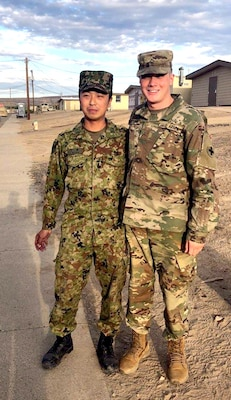 Pfc. Kyle Brennan poses with a member of the Japanese Ground Self-Defense during Rising Thunder 19.
