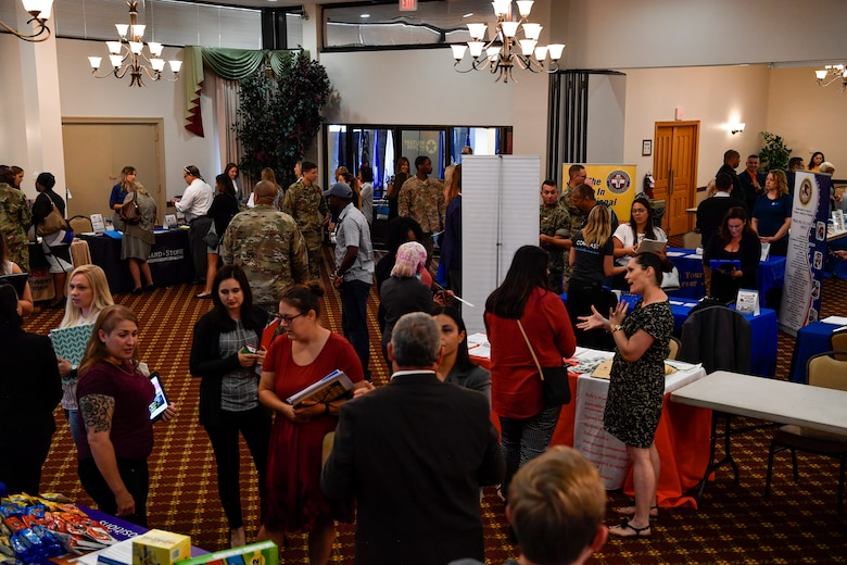 Patrons attending the Military Spouse Hiring Event interact with potential employers at Joint Base McGuire-Dix-Lakehurst, New Jersey, Sept. 12, 2019. During the event, more than 175 spouses received information on job opportunities, applied for employment and received professional headshots for their LinkedIn accounts. The event was hosted by Hiring our Heroes, a U.S. Chamber of Commerce Foundation.