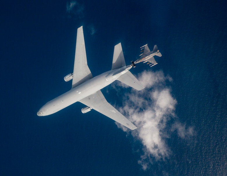 An F-16 from receives fuel from a KC-10 Extender