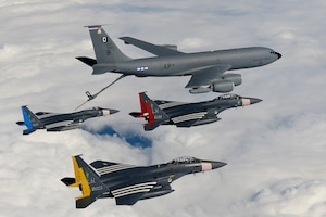 An F-15C Eagle and two F-15E Strike Eagles rendezvous with a KC-135 Stratotanker