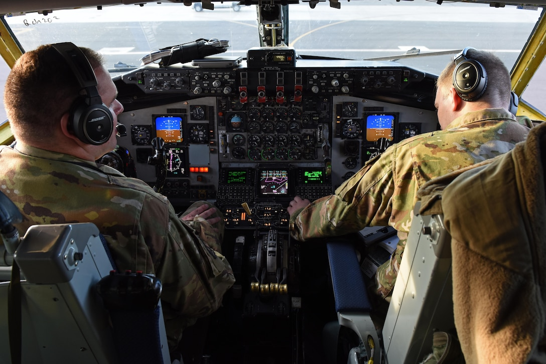 U.S. Air Force Capt. Justin Medlen, Operation Juniper Micron 384th Air Refueling Squadron aircraft commander (left) and 1st Lt. Colton Currier, 384th ARS co-pilot, prepare for take-off from Fairchild Air Force Base, Washington, in preparation to support Operation Juniper Micron Sept. 2019.