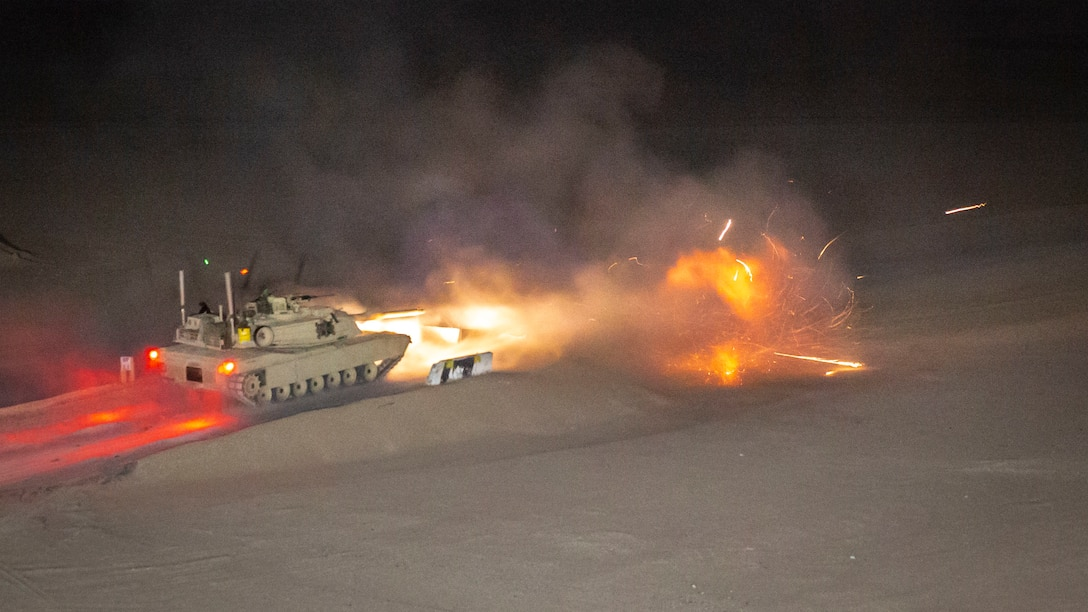 An M1A1 Abrams tank, attached to India Company, Battalion Landing Team 3/5, 11th Marine Expeditionary Unit, fires its main battle gun during a live-fire exercise. The Boxer Amphibious Ready Group and 11th MEU are deployed to the U.S. 5th Fleet area of operations in support of naval operations to ensure maritime stability and security in the Central Region, connecting the Mediterranean and the Pacific through the Western Indian Ocean and three strategic choke points.