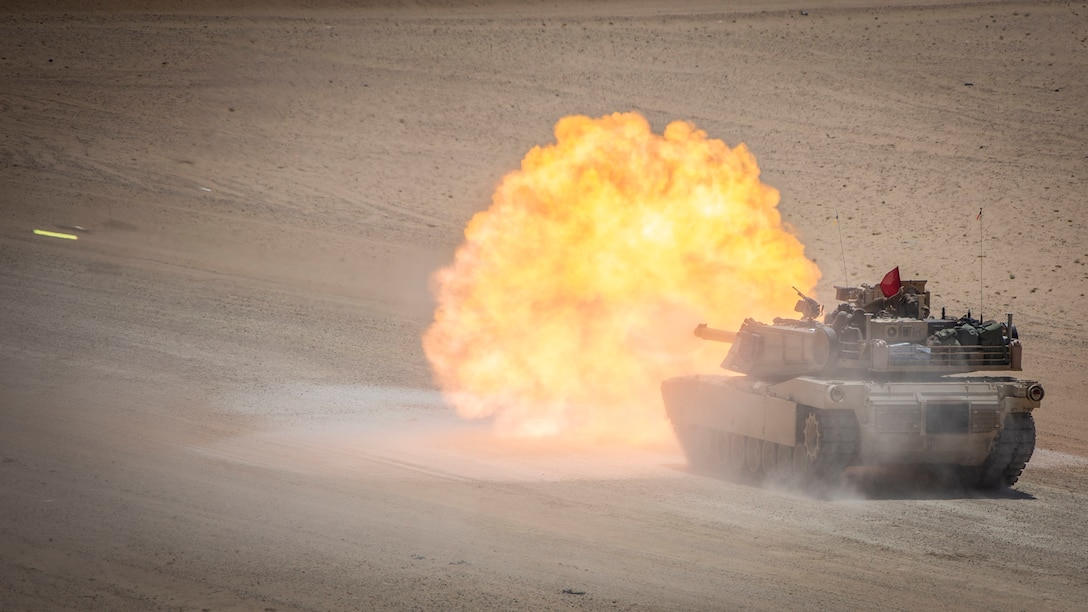 An M1A1 Abrams tank, attached to India Company, Battalion Landing Team 3/5, 11th Marine Expeditionary Unit, fires its main gun during a live-fire exercise. The Boxer Amphibious Ready Group and 11th MEU are deployed to the U.S. 5th Fleet area of operations in support of naval operations to ensure maritime stability and security in the Central Region, connecting the Mediterranean and the Pacific through the Western Indian Ocean and three strategic choke points.