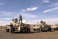 Troops from the Illinois National Guard prepare to depart on a live fire exercise during Rising Thunder 19.