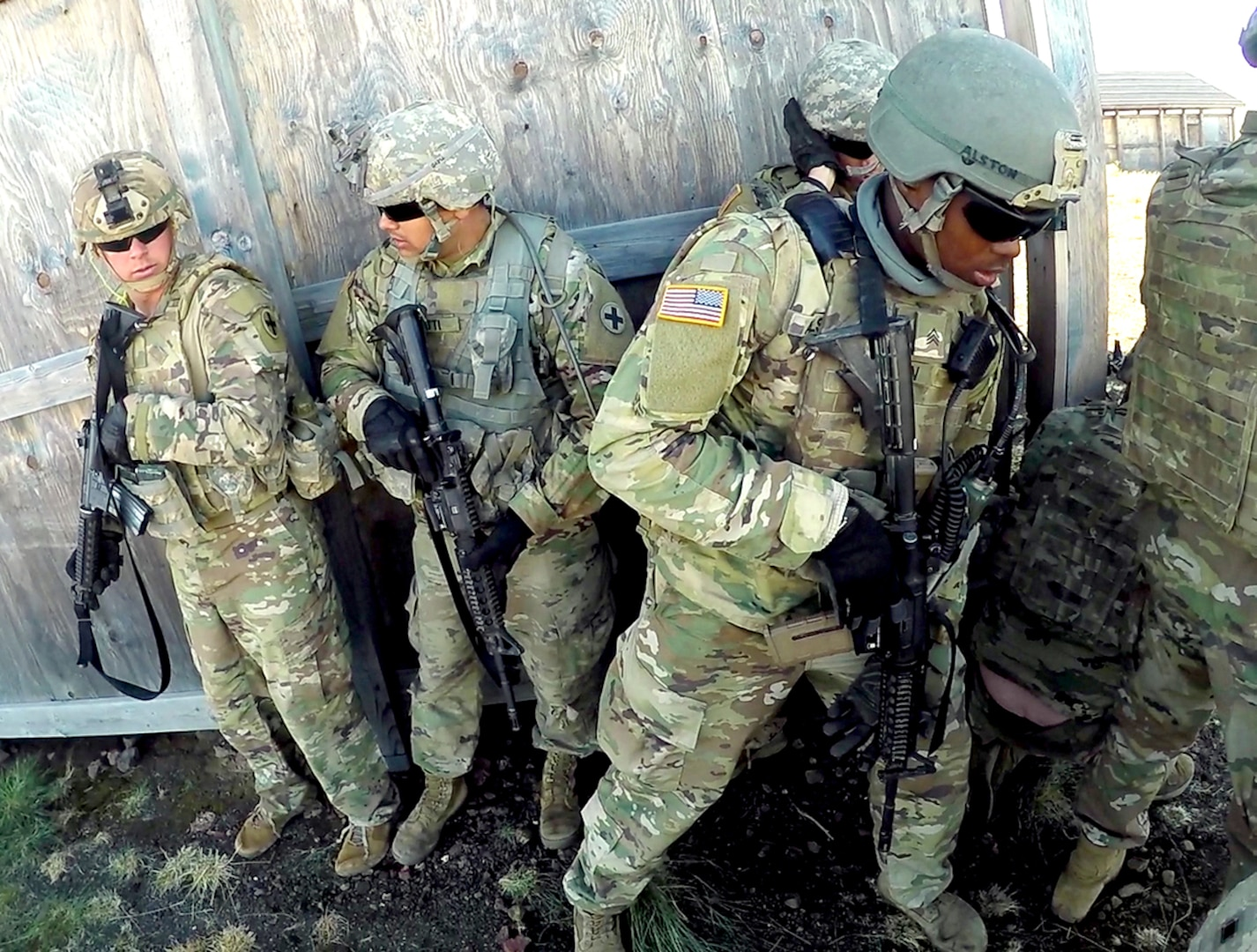 Soldiers from the Illinois National Guard stack to prepare to breach a structure during the live fire exercise for Rising Thunder 19.