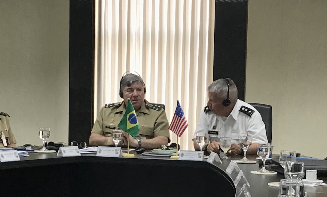 Lt. Gen. Todd Semonite and Col. Sebastien Joly, USACE Mobile District commander, discuss USACE partnership with Brazilian counterparts in military engineering and water management.