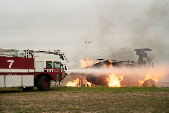 319th CES and Grand Forks International Airport firefighters joined to practice combating aircraft fires in an effort to train on readiness and maintain community relationships.