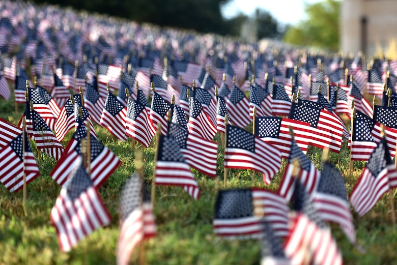 Small flags on display outside the San Angelo Fine Arts Museum during the 9/11 Memorial Ceremony in San Angelo, Texas, Sept. 11, 2019. Nearly 3,000 flags were displayed to honor all those who lost their lives in the collapse of the World Trade Center. (U.S. Air Force photo by Senior Airman Seraiah Wolf/Released)