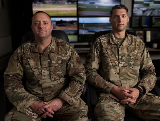 Master Sgt. Lawrence Price, assigned to the 7th Security Forces Squadron at Dyess Air Force Base, Texas, poses for a portrait with 1st Lt. Andrew Williams, assigned to the 509th SFS at Whiteman Air Force Base, Missouri, on Sept. 10, 2019, at Royal Air Force Fairford, England. Price and Williams have collaborated as the U.S.  SF leadership team at RAF Fairford, establishing processes and procedures for the Bomber Task Force they deployed in support of as well as future SF elements that wll rotate through the isntallation. Price and Williams lead the BTF SF element, which comprises defenders from Whiteman AFB, Dyess AFB, Barksdale Air Force Base, Louisiana, as well as Ramstein and Spangdahlem Air Bases in Germany. (U.S. Air Force photo by Staff Sgt. Kayla White)
