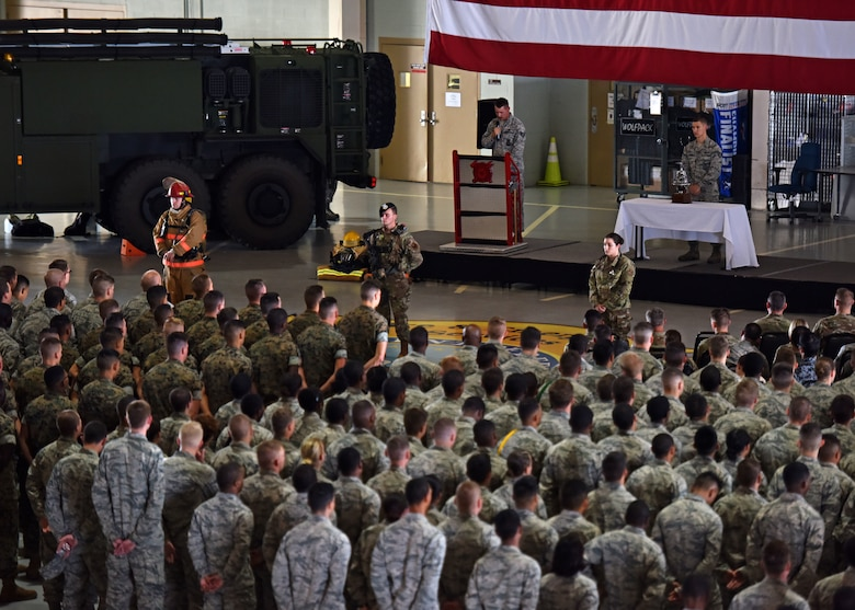 Students of the 312th Training Squadron stand in formation at the Firefighter Remembrance Ceremony in the Department of Defense Louis F. Garland Fire Academy on Goodfellow Air Force, Texas, Sept. 11, 2019. The 312th TRS trains, develops and inspires warriors to deliver fire emergence services for the Department of Defense and America's international partners. (U.S. Air Force photo by Senior Airman Seraiah Wolf/Released)