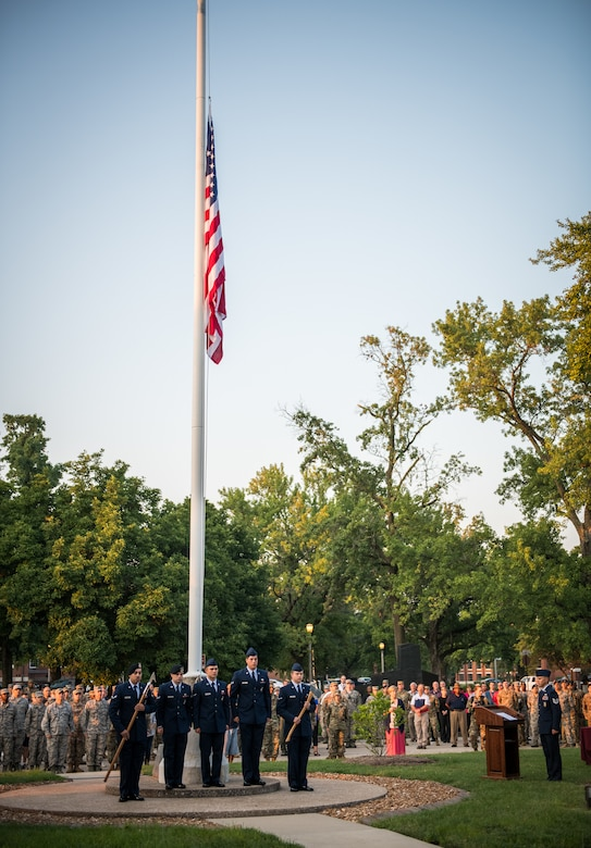 Team Scott members honor those killed during the tragic events of September 11, 2001 during a memorial reveille, Sept. 11, 2019, Scott Air Force Base, Illinois. Jennifer Welch who was in the Pentagon when the attacks occurred was the guest speaker for the event.  (U.S. Air Force photo by Master Sgt. Christopher Parr)