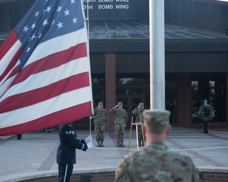 Gen. Tim Ray, Commander, Air Force Global Strike Command (Center) accompanied by Col. Jeffrey Schreiner, Commander, 509th Bomb Wing (Left) and Col. Ken Eaves, Commander, 131st Bomb Wing (Right) salute the Flag during a 9/11 Remembrance Ceremony at Whiteman Air Force Base, Missouri, Sep.11 2019.  Whiteman AFB Base Honor Guard raises the flag to half staff.  (U.S. Air Force Photo by Senior Airman Ashley Adkins)