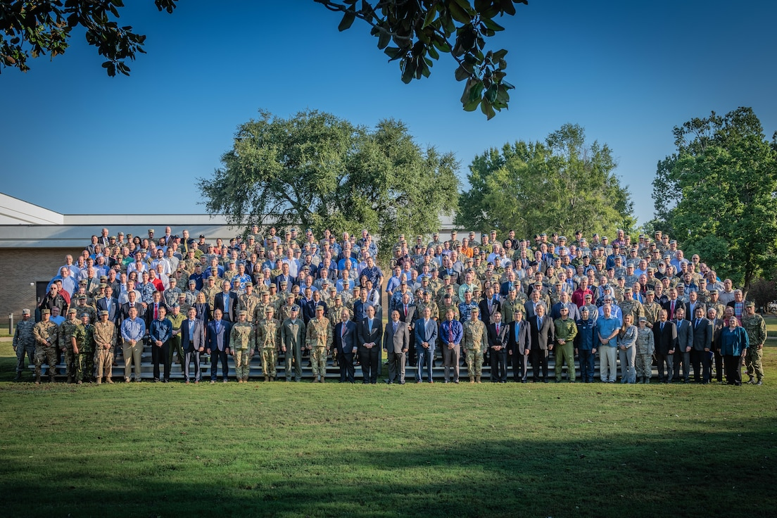 """Gen. John W. """"Jay"""" Raymond, United States Space Command and Air Force Space Command commander, stands with participants of Schriever Wargame 2019. More than 350 military and civilian experts from 27 agencies around the country, as well as Australia, Canada, New Zealand and the United Kingdom, participated in the wargame to explore multi-domain space operations. (U.S. Air Force photo by Trey Ward)"""