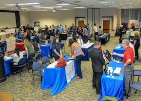 Job seekers and local employers attend a Spouse Employment Job Fair at the Airmen and Family Readiness Center on Edwards Air Force Base, California, Sept. 13. (U.S. Air Force photo by Giancarlo Casem)