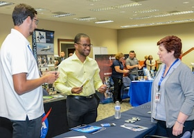 Team Edwards member Arman Johnson speaks with a local business representative during a Spouse Employment Job Fair at the Airmen and Family Readiness Center on Edwards Air Force Base, California, Sept. 13. (U.S. Air Force photo by Giancarlo Casem)