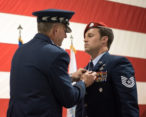 Air Force Chief of Staff Gen. David L. Goldfein (left) pins the Air Force Cross to the uniform of Tech. Sgt. Daniel Keller, a combat controller in the 123rd Special Tactics Squadron, during a ceremony at the Kentucky Air National Guard Base in Louisville, Ky, Aug.13, 2019. Keller earned the award — second only to the Medal of Honor — for valor on the battlefield in Afghanistan. (U.S. Air National Guard photo by Staff Sgt. Joshua Horton)