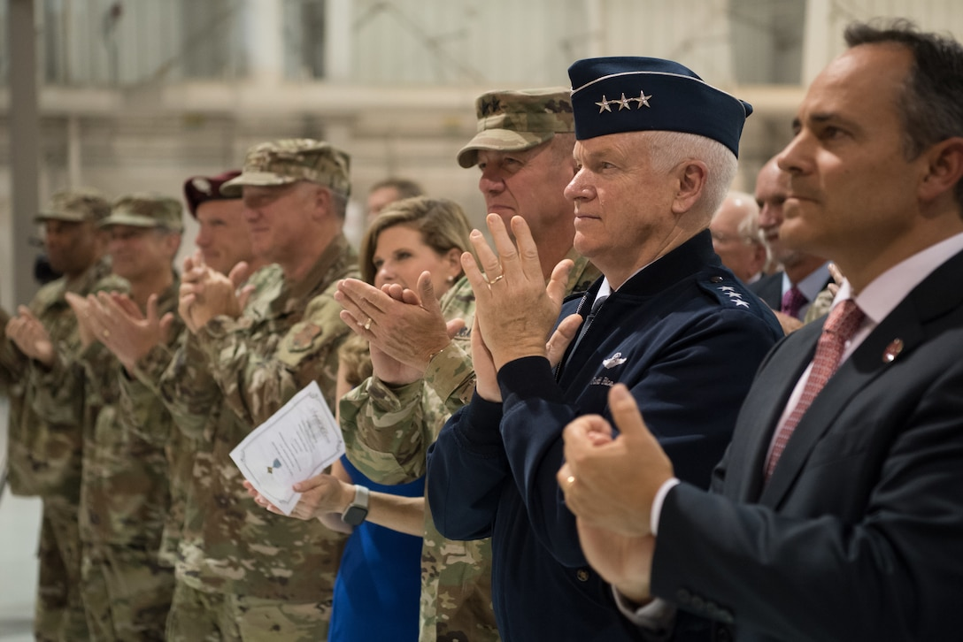 Kentucky Gov. Matt Bevin (far right), Lt. Gen. L. Scott Rice (second from right), director of the Air National Guard, and Army Maj. Gen. Stephen R. Hogan (third from right), adjutant general of the Kentucky National Guard, applaud Tech. Sgt. Daniel Keller, a combat controller in the 123rd Special Tactics Squadron, during a ceremony at the Kentucky Air National Guard Base in Louisville, Ky, Aug.13, 2019. At the ceremony, Air Force Chief of Staff Gen. David L. Goldfein presented Keller with the Air Force Cross, which Keller earned for valor on the battlefield in Afghanistan. (U.S. Air National Guard photo by Staff Sgt. Joshua Horton)