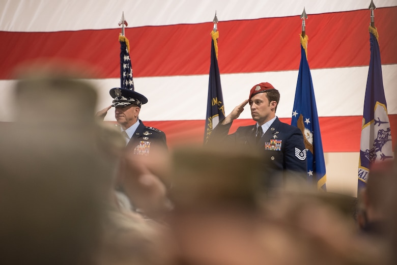 Air Force Chief of Staff Gen. David L. Goldfein (left) and Tech. Sgt. Daniel Keller, a combat controller in the 123rd Special Tactics Squadron, salute during the national anthem as part of an award ceremony at the Kentucky Air National Guard Base in Louisville, Ky, Aug.13, 2019. At the ceremony, Goldfein presented Keller with the Air Force Cross, which Keller earned for valor on the battlefield in Afghanistan. (U.S. Air National Guard photo by Staff Sgt. Joshua Horton)
