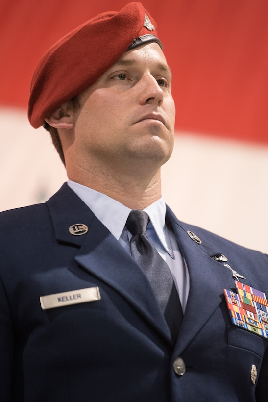 Tech. Sgt. Daniel Keller, a combat controller in the 123rd Special Tactics Squadron, stands at attention during an award ceremony at the Kentucky Air National Guard Base in Louisville, Ky, Aug.13, 2019. At the ceremony, Air Force Chief of Staff Gen. David L. Goldfein presented Keller with the Air Force Cross, which Keller earned for valor on the battlefield in Afghanistan. (U.S. Air National Guard photo by Staff Sgt. Joshua Horton)