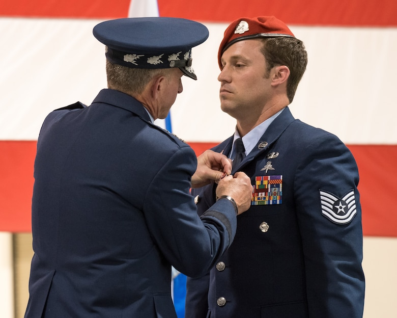 Air Force Chief of Staff Gen. David L. Goldfein (left) pins the Air Force Cross to the uniform of Tech. Sgt. Daniel Keller, a combat controller in the 123rd Special Tactics Squadron, during a ceremony at the Kentucky Air National Guard Base in Louisville, Ky, Aug.13, 2019. Keller earned the award — second only to the Medal of Honor — for valor on the battlefield in Afghanistan. (U.S. Air National Guard photo by Dale Greer)
