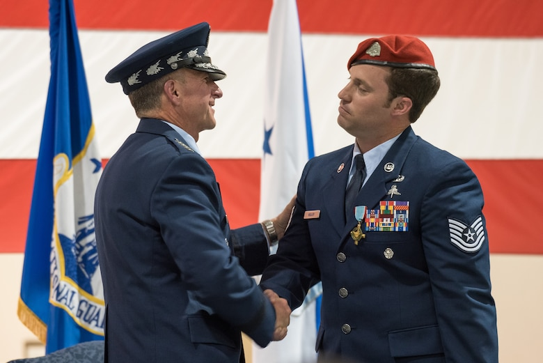 Air Force Chief of Staff Gen. David L. Goldfein (left) shakes hands with Tech. Sgt. Daniel Keller, a combat controller in the 123rd Special Tactics Squadron, during a ceremony at the Kentucky Air National Guard Base in Louisville, Ky, Aug.13, 2019. Earlier in the ceremony, Goldfein presented Keller with the Air Force Cross, which Keller earned for valor on the battlefield in Afghanistan. (U.S. Air National Guard photo by Dale Greer)