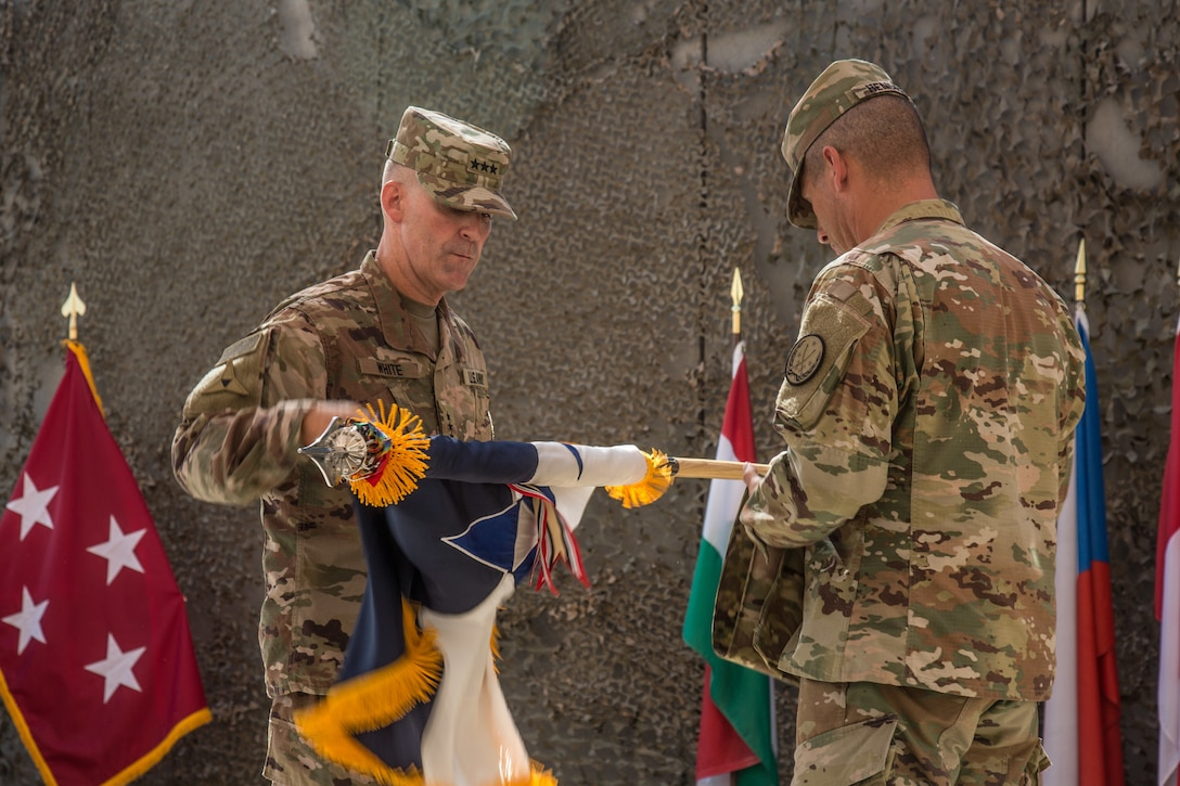 U.S. Army Lt. Gen. Robert White, commanding general of III Armored Corps, and Command Sgt. Maj. Daniel Hendrex, command sergeant major of III Armored Corps, uncase the III Armored Corps colors at the Combined Joint Task Force – Operation Inherent Resolve transfer of authority ceremony in Baghdad, Iraq, Sept. 14, 2019. The U.S. Army's XVIII Airborne Corps, deployed from Fort Bragg, North Carolina to areas in Southwest Asia, transferred its command authority to the III Armored Corps, deployed from Fort Hood, Texas. CJTF-OIR is a 81-member global coalition, which works by, with, and through partner forces to defeat ISIS in designated areas of Iraq and Syria, and sets conditions for follow-on operations to increase regional stability.