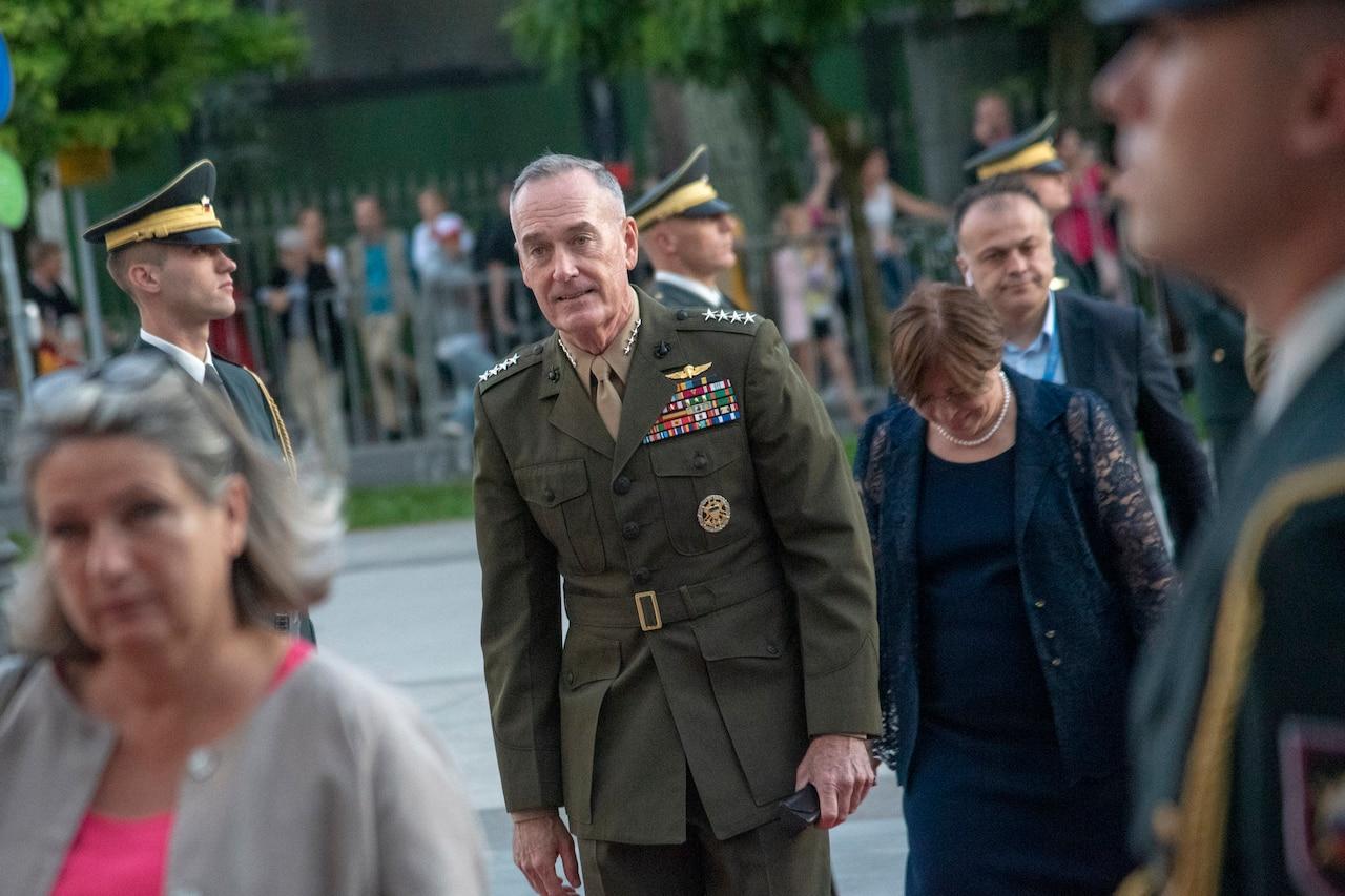 General walks through honor cordon.