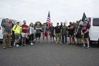 Participants prepare for the 100 mile ruck march on Joint Base McGuire-Dix-Lakehurst, New Jersey Sept. 10, 2019. Every year volunteers walk from Joint Base MDL to the 9/11 Memorial, New York City to raise money along the way while informing passersby of the cause. Throughout the 100 miles, participants took turns carrying a prisoner of war/missing in action flag along with an American flag that served in Afghanistan to commemorate the individuals who lost their lives during the attacks. (U.S. Air Force photo by Airman 1st Class Ariel Owings)