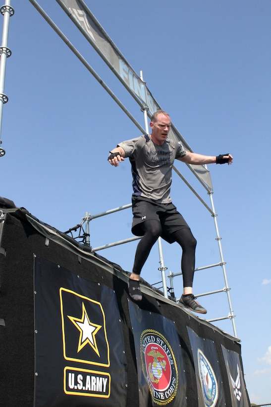U.S. Navy Commander Timothy White jumps to the finish line at the end of his heat of the 2019 Alpha Warrior Inter-Service Battle Sept. 14, 2019, at Retama Park, Selma, Texas. Winning the team event for the second consecutive year was the U.S. Air Force, followed by the U.S. Army. (U.S. Air Force photo by Debbie Aragon)