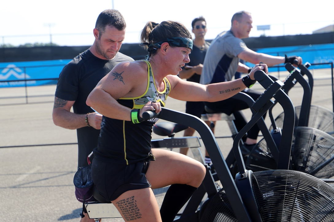 U.S. Army Sgt. Bawnie Sutton pedals an air bike during her heat of the 2019 Alpha Warrior Inter-Service Battle Sept. 14, 2019, at Retama Park, Selma, Texas. Sutton and her five team mates finished the competition in second place, behind the U.S. Air Force. The U.S. Navy finished third. (U.S. Air Force photo by Victoria Ribiero)