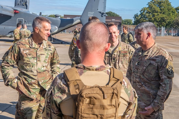 U.S. Army Gen. Richard D. Clarke, United States Special Operations Command commander, speaks with U.S. Air Force Maj. Gen. Kirk W. Smith, Special Operations Command Europe commander, on a tour of the 352nd Special Operations Wing at RAF Mildenhall, England, Sept. 12, 2019. The mission of the 352nd SOW, part of Air Force Special Operations Command, is to provide combat ready, responsive, specialized airpower and combat support to execute the full spectrum of SOF missions. (U.S. Air Force photo by Airman 1st Class Joseph Barron)