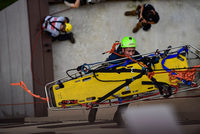 Senior Airman James Selph, 51st Civil Engineer Squadron firefighter, descends an eight-story building to perform a rescue scenario during a Department of Defense Rescue Technician course, Sept. 9, 2019, at Osan Air Base, Republic of Korea. Instructors from Andersen Air Force Base, Guam's 554th RED HORSE Squadron trained and tested 10 Pacific Air Forces firefighters from three bases on high-risk, elevated and confined space rescue tactics. (U.S. Air Force photo by Staff Sgt. Greg Nash)