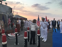 Cmdr. John B. Benfield, commanding officer of the guided-missile destroyer USS Ramage (DDG 61), greets U.S. Ambassador to Lebanon, Elizabeth Richard, during a reception. Ramage made an historic port visit to Beirut on Sept. 14, the first time in 36 years a U.S. warship had pulled into the country.