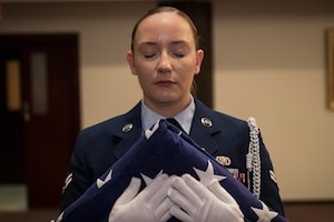 U.S. Air Force Airman 1st Class Molly Collyer, 39th Air Base Wing honor guardsmen holds a folded flag during a 9/11 remembrance ceremony Sept. 11, 2019, at Incirlik Air Base, Turkey. The flag folding honored the brave men and women who lost their lives as a consequence of the 9/11 terrorist attacks and resulting conflicts. (U.S. Air Force photo by Staff Sgt. Ceaira Tinsley)