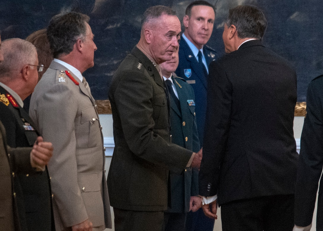 Marine Corps Gen. Joe Dunford, chairman of the Joint Chiefs of Staff, meets the President of the Republic of Slovenia Borut Pahor during the opening ceremony of the North Atlantic Treaty Organization Military Committee Conference at the National Gallery in Ljubljana, Slovenia,  Sept. 13, 2019.