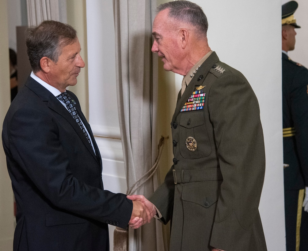 Marine Corps Gen. Joe Dunford, chairman of the Joint Chiefs of Staff, meets Karl Erjavec, the Slovenian minister of defense, during the opening ceremony of the North Atlantic Treaty Organization Military Committee Conference at the National Gallery in Ljubljana, Slovenia,  Sept. 13, 2019.