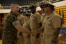 U.S. Marine Corps Maj. Gen. Stephen M. Neary, II Marine Expeditionary Force deputy commanding general and II Marine Expeditionary Brigade commanding general, congratulates the newly promoted chief petty officers during the Chief Petty Officer Pinning Ceremony on Camp Lejeune, N.C., Sept. 13, 2019. Thirty-three chief selects were pinned to the rank of chief petty officer and among them were two Marines that earned the title of honorary chief petty officer. Before the chief selects can pin on their new rank, they must go through a six-week initiation course in order to instill the trust that is inherent with the donning of the uniform of a chief. (U.S. Marine Corps photo by Cpl. Leynard Plazo)