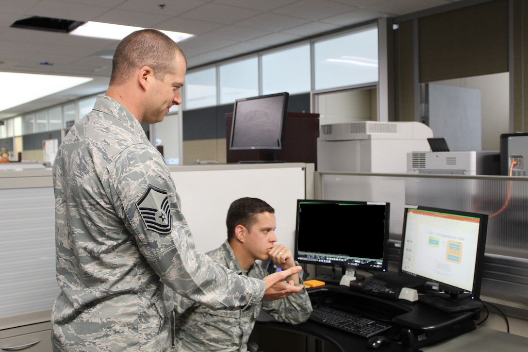 Master Sgt. David Meyers, 718th Intelligence Squadron, works with Staff Sgt. Pike Pemsteiner, 45th Intelligence Squadron, on the Gorgon Stare 2 sensor program.  Meyers was recommended to help the 45th IS with the GS 2 program because he had previous program management and training experience, to continue building the capability.
